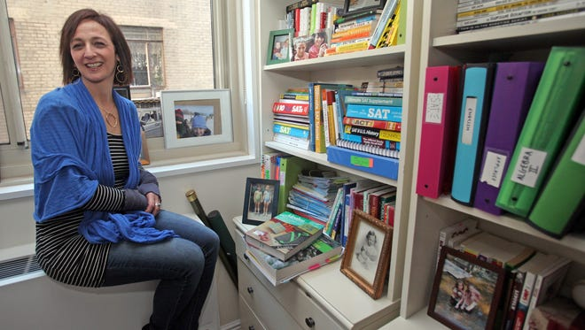 """Author Debbie Stier's new book, """"The Perfect Score Project: Uncovering the Secrets of the SAT,"""" chronicles her experience taking the SAT seven times to help motivate and prepare her college-bound son. Stier was photographed in her Manhattan home Feb. 28, 2014."""