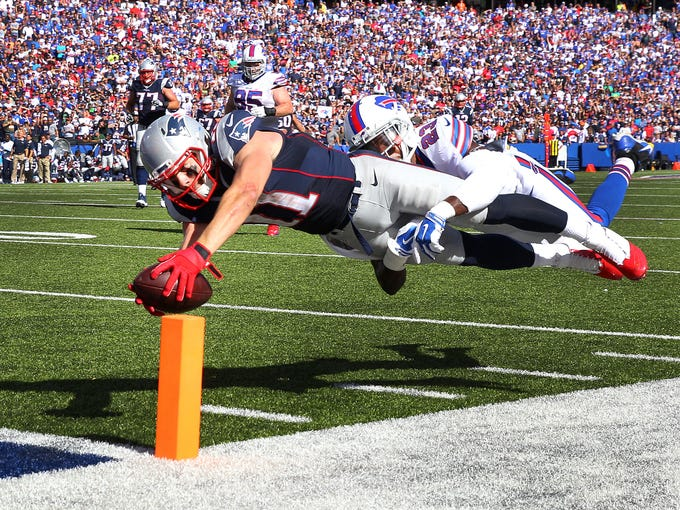 Patriots  receiver Julian Edelman dives into the end