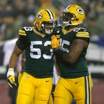 Green Bay Packers outside linebacker Nick Perry, left, celebrates his sack of Minnesota Vikings quarterback Christian Ponder with Datone Jones in the first quarter.
