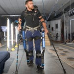 Paralyzed Pace High grad and pilot Mark Daniel straps on the  Mina v2 exoskeleton developed by the Institute for Human & Machine Cognition (IHMC) before completing an obstacle course at the IHMC facility in Pensacola on Wednesday, September 28, 2016.  Daniel and the IHMC team will be competing at the Cybathlon competition in Zurich, Switzerland, on October 8th.