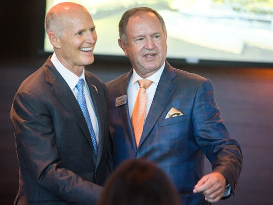Gov. Rick Scott, left, and Arthrex founder Reinhold Schmieding discuss Arthrex's upcoming expansion at its corporate headquarters building in North Naples on Thursday, Nov. 9, 2017.