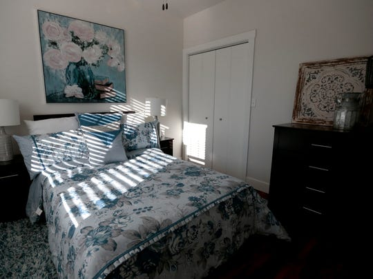 A bedroom in a one bedroom apartment at the Talia Apartments