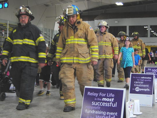 Paul Beder, front right, of the Waupun Fire Department,