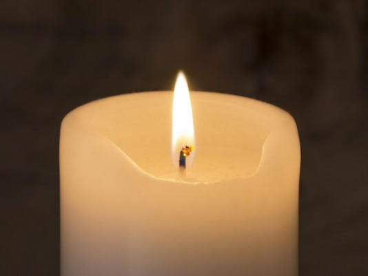 Candle on wooden Background