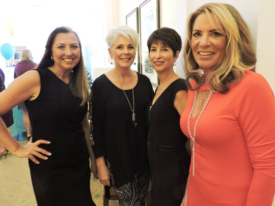Models Heidi Monsour, Deb Pfrogner, Gail Maidrand and Jane Harlan strolled through the dining room during the recent Mary's Shelter luncheon.