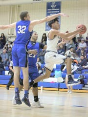 Johnny Harris drives to the lane during action against