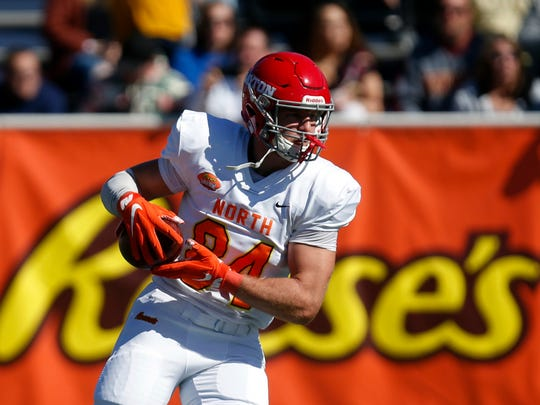 North tight end Adam Trautman of Dayton (84) warms up before the start of the Senior Bowl college football game Saturday, Jan. 25, 2020, in Mobile, Ala. (AP Photo/Butch Dill)