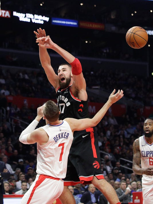 Toronto Raptors' Jonas Valanciunas, top, is fouled by Los Angeles Clippers' Sam Dekker during the second half of an NBA basketball game Monday, Dec. 11, 2017, in Los Angeles. The Clippers won 96-91. (AP Photo/Jae C. Hong)