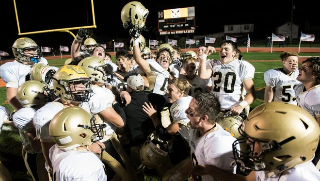 The Delone Catholic Squires celebrate after blanking Hanover 54-0 on Nov. 3, 2017.