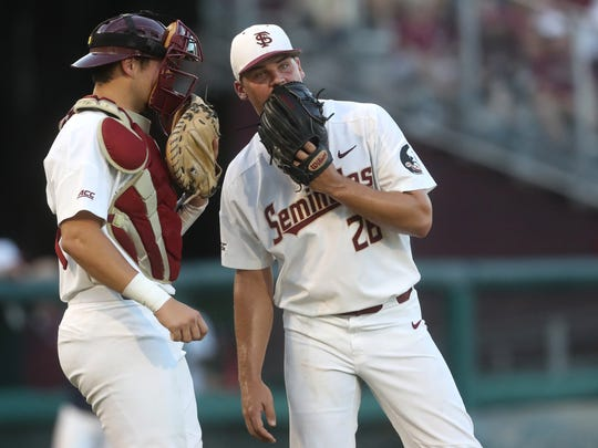 FSU's Cole Sands talks to catcher Cal Raleigh against