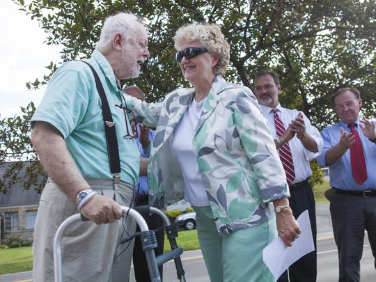 Michael Organ smiles after Staunton Mayor Carolyn Dull gave a speech about his accomplishments during a ceremony along West Beverley Street honoring his legacy supporting Newtown and the city's west end on Thursday, Aug. 27, 2015.