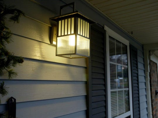 Check the condition of the home for paint. Paint the front door and trim for a fresh loo. Or replace the porch light.