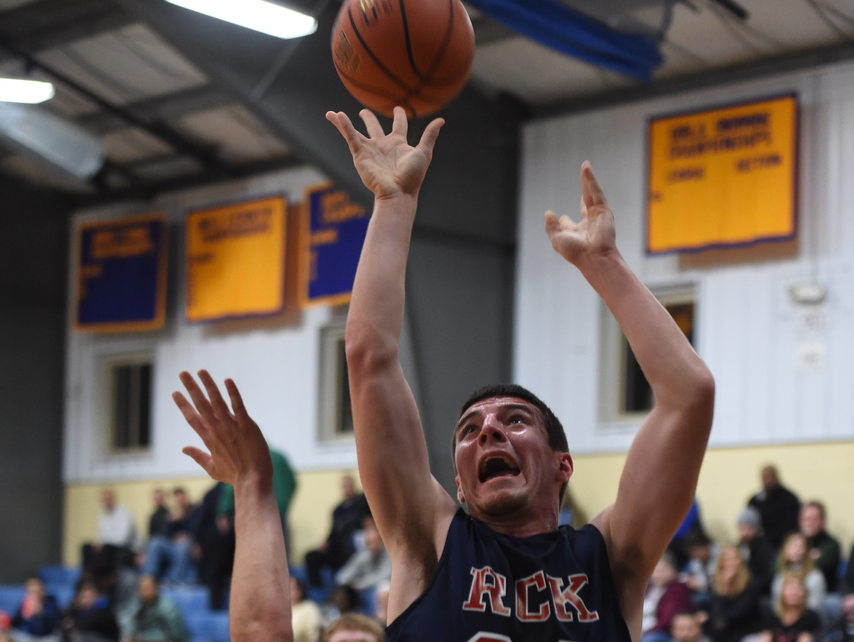 Ketcham's Tim Reilly shoots the ball over Arlington's Evan Greco during the Duane Davis Memorial Holiday Tournament in Poughkeepsie on Wednesday.
