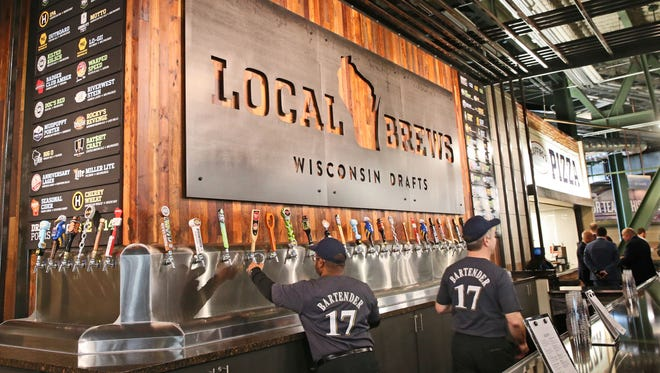 Bartenders Anton Duncan (left) and Curt Wambach stand ready to help customers at Miller Park during an unveiling of new food and drink options. The Local Brews, Wisconsin Drafts has 24 different local beers for sale and on tap at Miller Park for opening day in April.