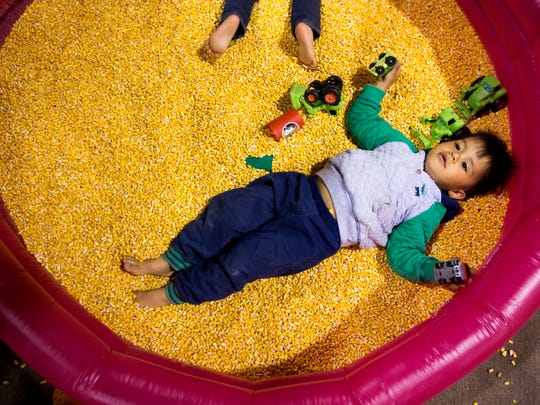Nicholas Matrix, 3, plays in a pool of corn at the Oregon Ag Fest on Saturday, April  23, 2016 at the State Fairgrounds. The annual two day event is full of demonstrations, activities and educational opportunities all centered around agriculture.