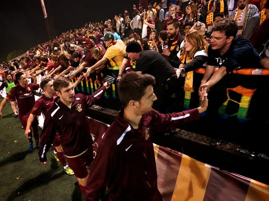 Detroit City FC players thanks the fans after their home opener against AFC Ann Arbor during DCFC on Friday, May 20, 2016, at the new Keyworth Stadium in Hamtramck, MI.