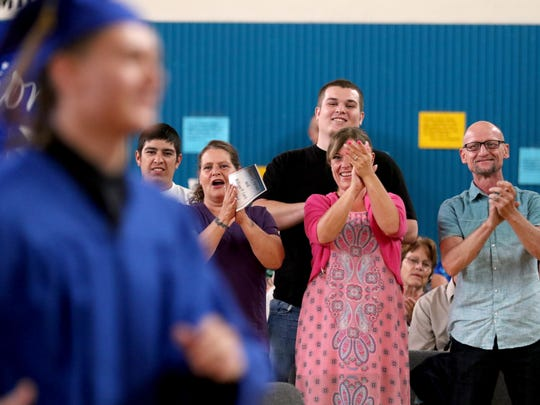 Timothy P. walks up to receive his high school diploma as members of his family, from left, Jesse Smart, Tammy McVay, Tanner Henderson, Sara Perdue and Timothy Perdue, all of Salem, cheer him on during a graduation ceremony for the Oregon Youth Authority at the Hillcrest Youth Correctional Facility in Salem on Wednesday, June 29, 2016. This is the last-ever graduation at Hillcrest before the facility is closed and students and staff are transferred to MacLaren in Woodburn by this time next year.