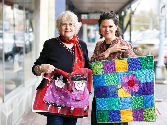 Gail Grier, left, and Crystal Matti, right, with Discover Quilting at Holding Court on Tuesday, Nov. 15, 2016.