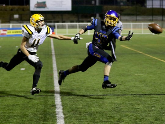 Cottage Grove's Jacob Woods (42) and Cascade's Brandon Martin (11) go after an overthrown ball in the first half of the Cascade vs. Cottage Grove OSAA Class 4A semifinal football game at Hillsboro Stadium on Saturday, Nov. 19, 2016.