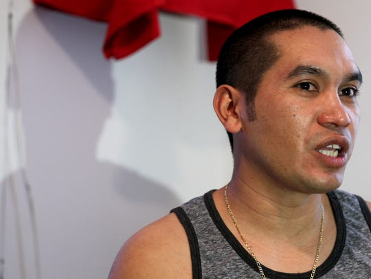 Carlos Larios is shown during an interview in his Long