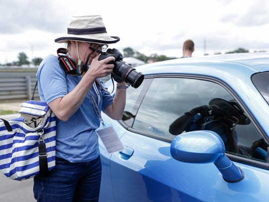 Jill Lee of Newtown Square, PA, takes a photo of the interior a 2018 Dodge Challenger SRT Demon during the Concours d'Elegance of America at M1 Concourse, Friday, July 28, 2017 in Pontiac.