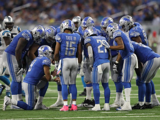 Matthew Stafford calls a play in the huddle in the third quarter of the Lions' 27-24 loss to the Carolina Panthers at Ford Field, Sunday, Oct. 8, 2017.