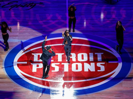 Rapper Dej Loaf, center, performs before the Detroit Pistons' home opener at the Little Caesars Arena in Detroit, Wednesday, October 18, 2017.