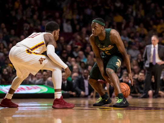 Michigan State's Cassius Winston dribbles in the first half against Minnesota last season.