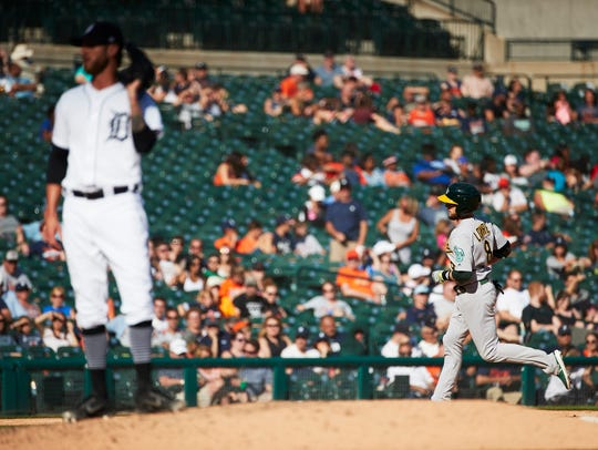 Jed Lowrie runs the bases after hitting a home run in the ninth inning against Tigers reliever Shane Greene at Comerica Park.