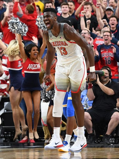 Mar 9, 2018; Las Vegas, NV, USA; Arizona Wildcats forward Deandre Ayton (13) celebrates after scoring against the UCLA Bruins in a Pac-12 Tournament semi-final at T-Mobile Arena. Mandatory Credit: Stephen R. Sylvanie-USA TODAY Sports