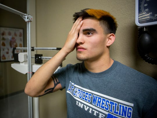 16-year-old Las Cruces High School student Emilio Marquez undergoes an eye exam at Arrowhead Park Medical Academy on March 2, 2016.