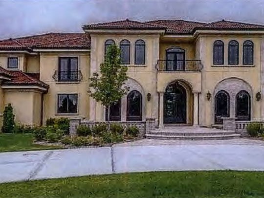 Albert Golant rented this house at a Waukesha County country club development for $7,000 a month, court records say. The house is on Legend Way in Wales.