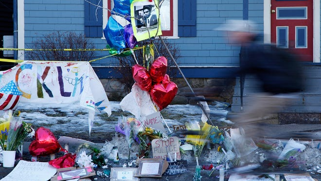 A memorial for Tony Robinson, 19, who was shot by a police officer Friday, March 6, 2015, at the site of the shooting in Madison, Wis., on Wednesday, March 11, 2015.