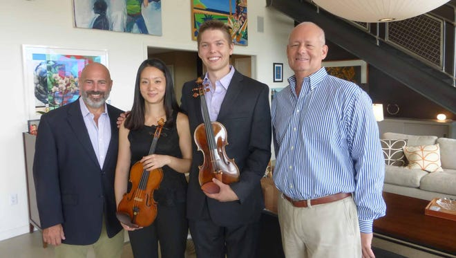 Former Birmingham resident and Musical Feasts host Jeff Antaya, DSO violinists Heidi Han and Will Haapaniemi and former Birmingham resident and Musical Feasts host Peter Rosenfeld. Antaya and Rosenfeld hosted the Musical Feasts brunch at their renovated modern and urban chic loft in Detroit.