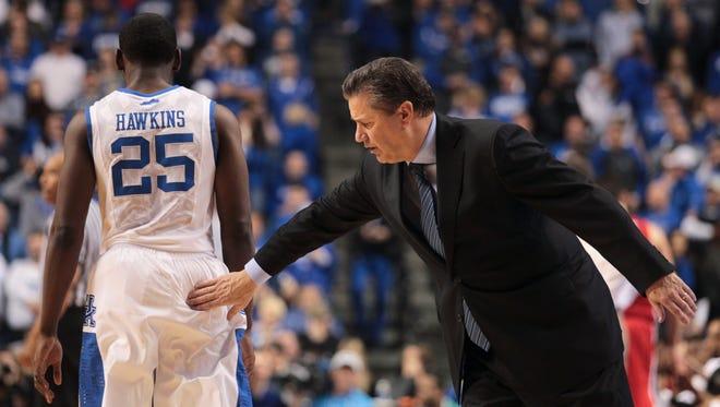 Kentucky Coach John Calipari gave some encouragment to Dominique Hawkins in the waning minutes against Georgia Saturday afternoon at Rupp Arena in Lexington. UK won 79-54.