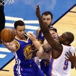 Stephen Curry (#30) of the Golden State Warriors passes the ball against Serge Ibaka (#9) of the Oklahoma City Thunder during the second half in game six of the Western Conference Finals during the 2016 NBA Playoffs at Chesapeake Energy Arena on Saturday in Oklahoma City, Okla.