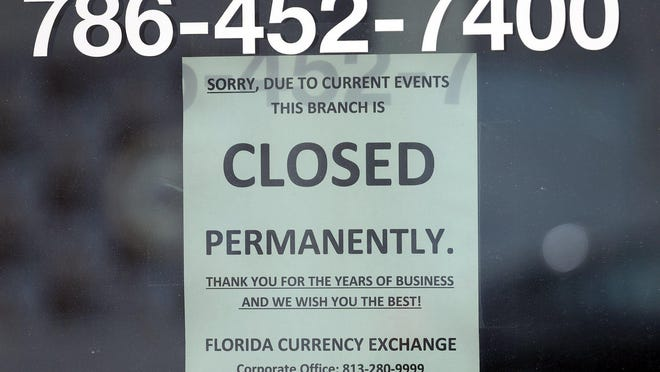 Florida Currency Exchange on Lincoln Mall in Miami Beach has closed permanently. Businesses throughout Lincoln Mall posted notices of their closure on doors and windows when COVID-19 pandemic policies forced the closure of most stores, restaurants, and bars except for takeout and online business on April 7. (Carl Juste/Miami Herald/TNS)