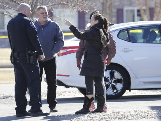 Officials talk to residents after an incident at Craftsman