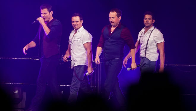 From left, Nick Lachey, Drew Lachey, Justin Jeffre and Jeff Timmons of 98 Degrees perform at the Jobing.com Arena on Sunday, July 14, 2013 in Glendale, Arizona. Stacie Scott/The Arizona Republic