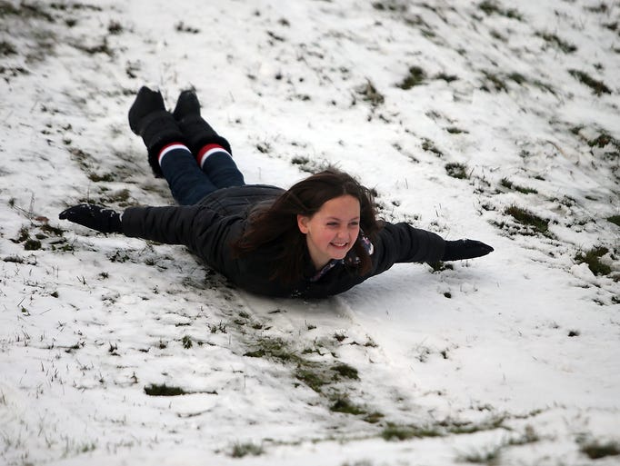 Alyssa Peaslee, 11, forgoes a sled and slides down