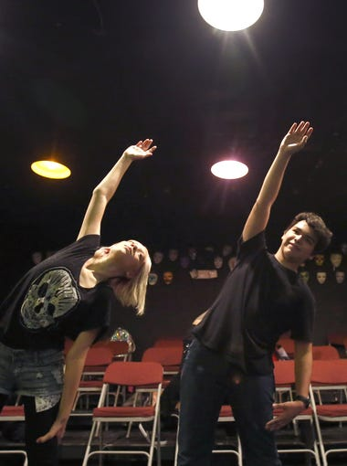 High school students Angie Metoyer, 14, left, Genaro Coroneo, 14, and Levi Robson, 15 stretch out and warm up in beginning drama at Metropolitan Arts Institute in Phoenix on Thursday, October 1, 2015.