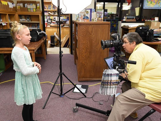 Wendy South of Wingard Photography photographs Norfork Elementary School student Lacy LaVoie on Wednesday during school picture day.