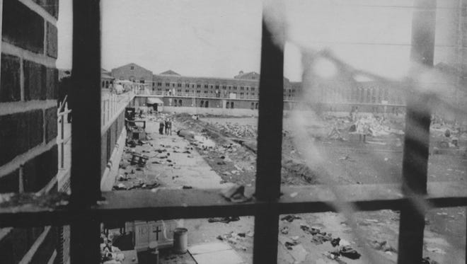 Broken glass frames the prison that was littered with debris after the inmate's uprising.