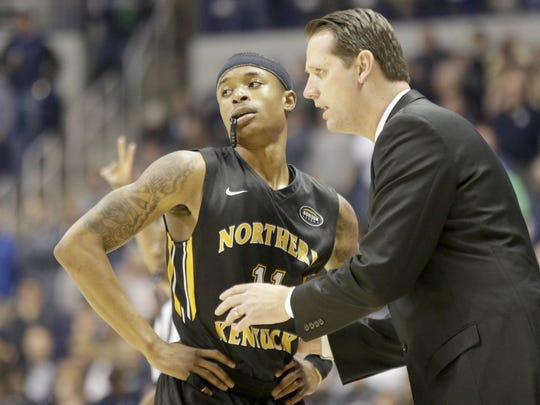 NKU coach John Brannen talks with Lavone Holland during