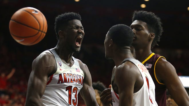 Arizona's Deandre Ayton (13) screams after scoring and drawing a foul against ASU's De'Quon Lake (35) during the first half at McKale Center on December 30, 2017 in Tucson, Ariz.