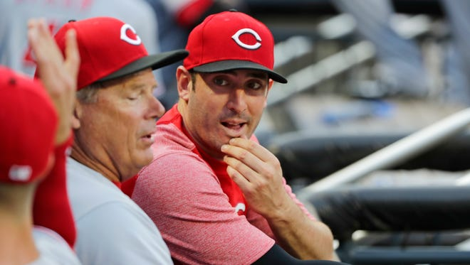 Cincinnati Reds' Matt Harvey talks with teammates before a baseball game against the New York Mets Monday, Aug. 6, 2018, in New York.