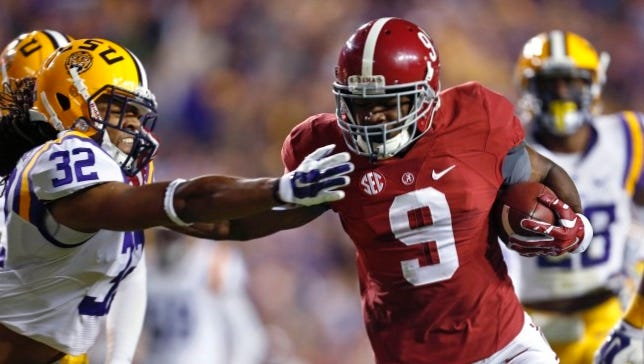 Alabama wide receiver Amari Cooper (9) eludes LSU cornerback Jalen Collins (32) on a 23-yard touchdown reception in the first half of an NCAA college football game in Baton Rouge, La., Saturday, Nov. 8, 2014. (AP Photo/Jonathan Bachman)