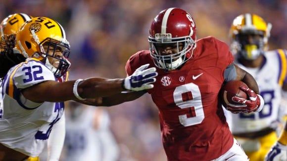 Alabama wide receiver Amari Cooper (9) eludes LSU cornerback