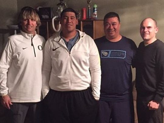 Samuel Poutasi, second from left, signed with the Ducks.