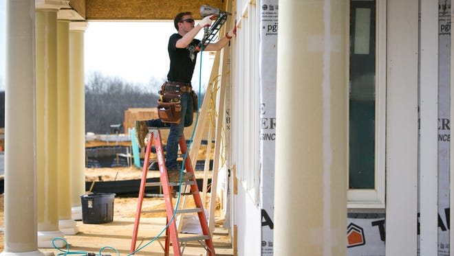Construction crews work on the Whitehall development in Middletown. The project is part a rapid population growth in southern New Castle County.
